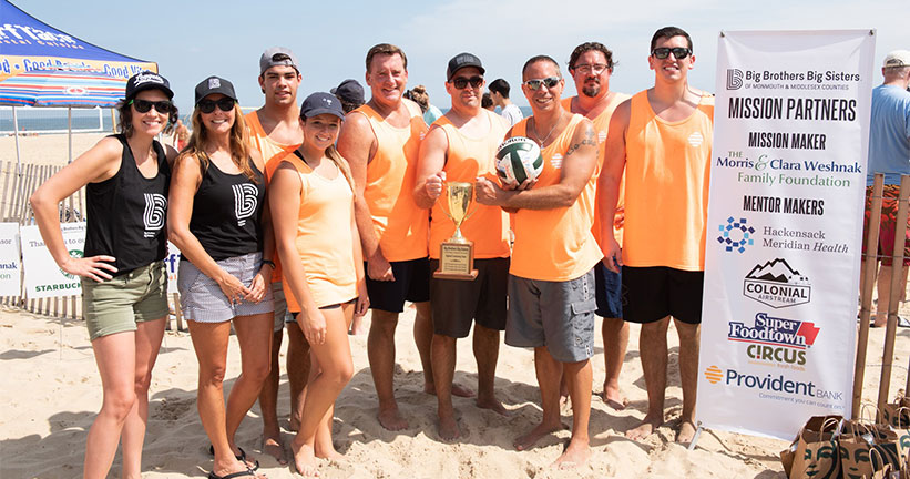 Members of Provident Bank's Sand Sharks volleyball team